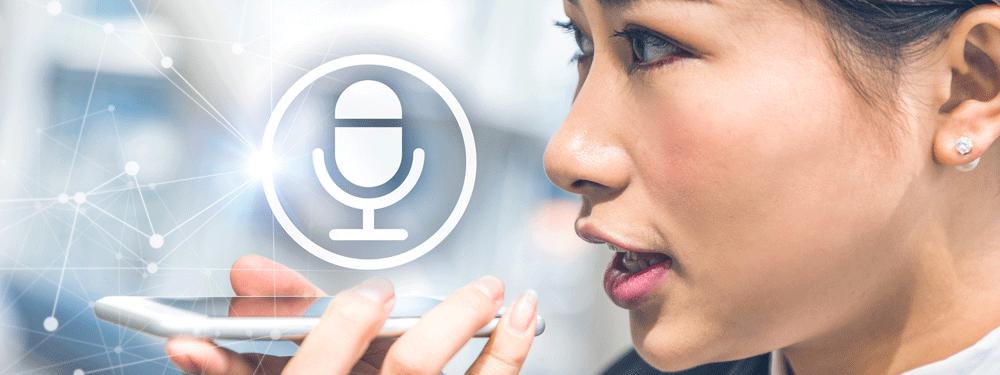 Woman recording a voice memo into a phone