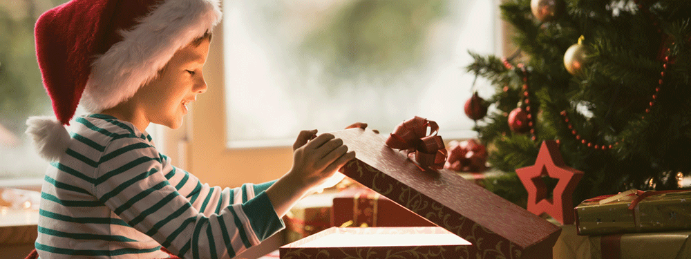 Little boy opening a gift