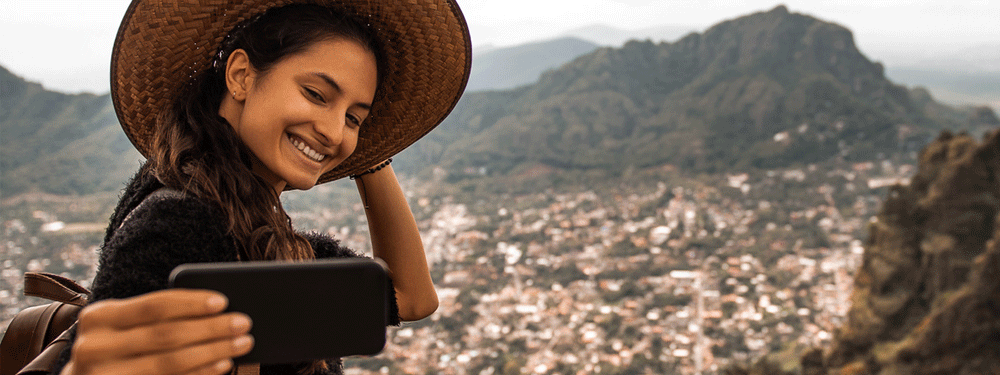 Woman taking a selfie and traveling