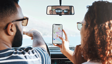 Couple using geolocation on maps while in car Featured