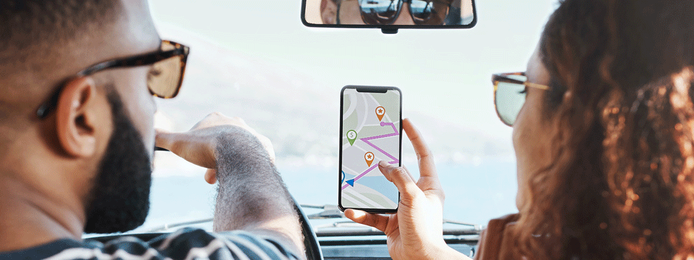 Couple using geolocation on maps while in car