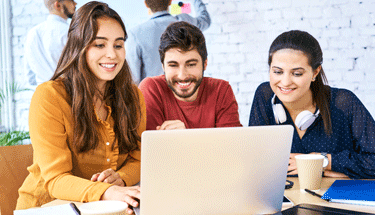 Group of Millennials working on a laptop Featured
