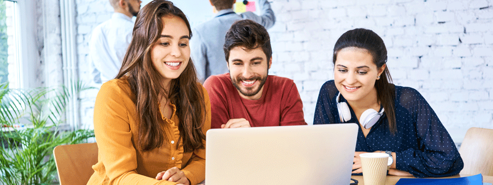 Group of Millennials working on a laptop