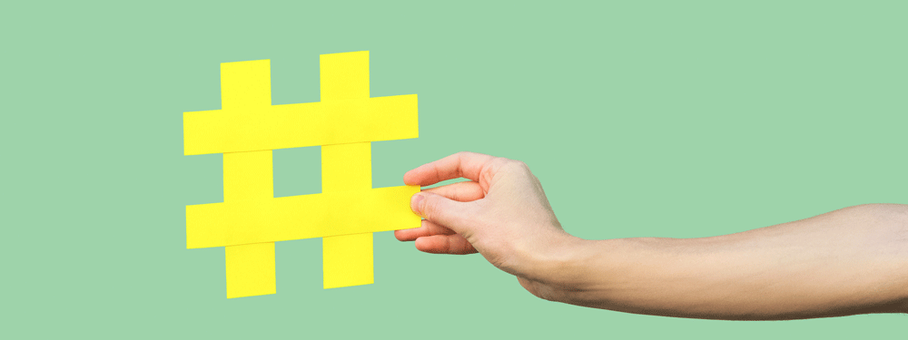 Person holding a yellow hashtag