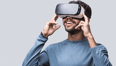 Man wearing a VR headset Featured