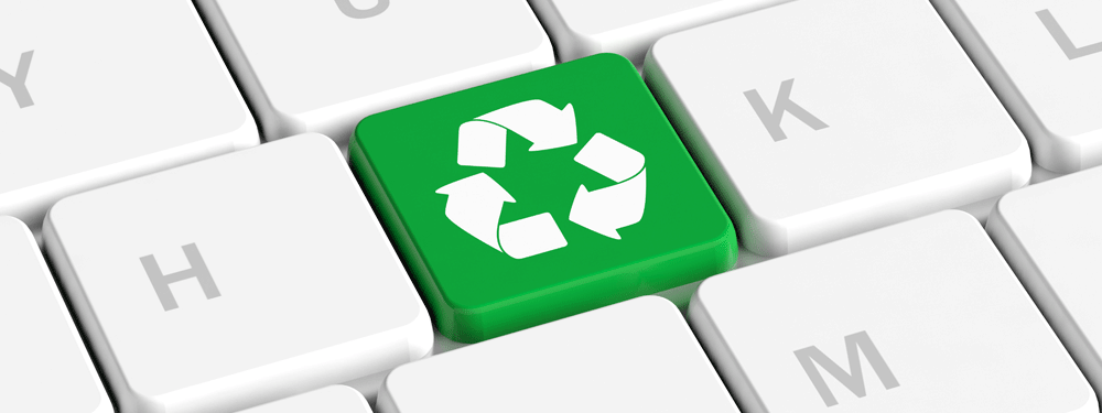 Green recycling button on a white keyboard