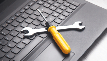 Small tools on a laptop computer Featured