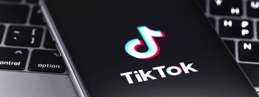 TikTok on cellphone on laptop