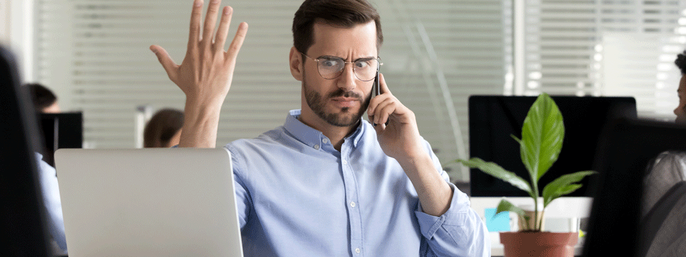 Frustrated business man getting robocall