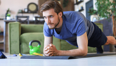Man working out at home Featured