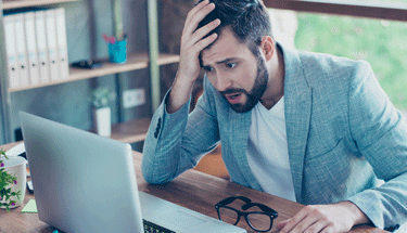 Man frustrated with slow internet Featured