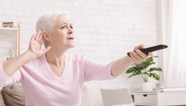 Mature woman having a hard time hearing the TV Featured