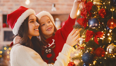 Mother and daughter decorating for the holidays Featured