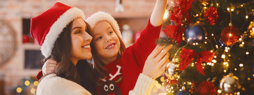 Mother and daughter decorating for the holidays