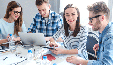 Group of 4 interacting at work Featured