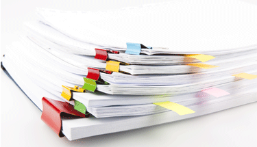 Neatly organized stack of papers Featured