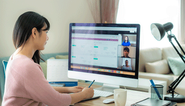 Woman working from home on a mac computer Featured