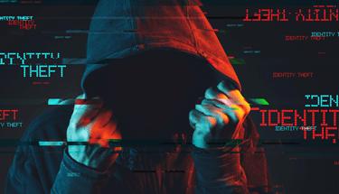 Hacker stealing an identity Featured