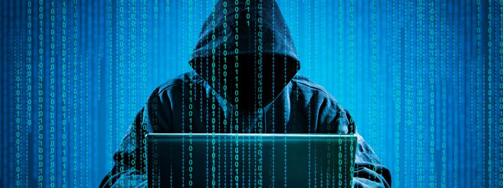 Hacker wearing a black hoodie