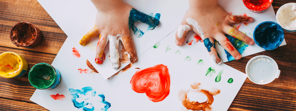 Kid painting at a table