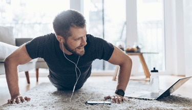 Man working out from home with app Featured