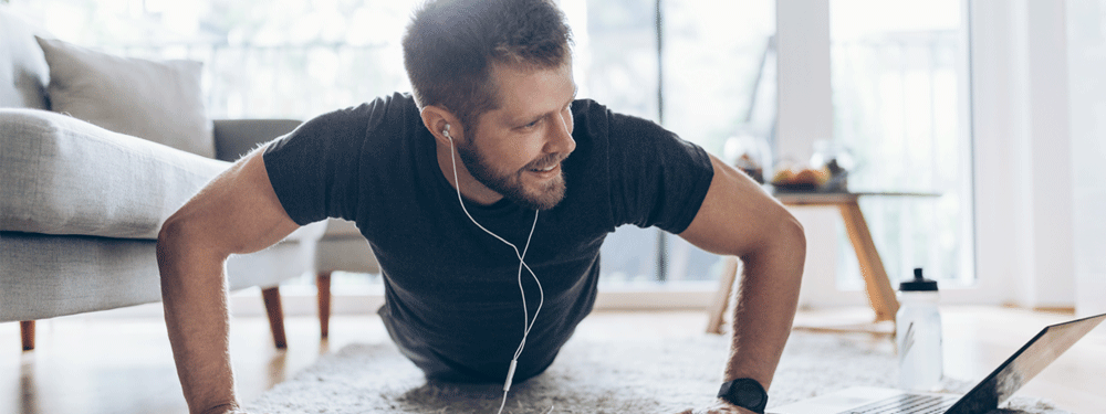 Man working out from home with app