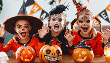 Three kids celebrating Halloween Featured