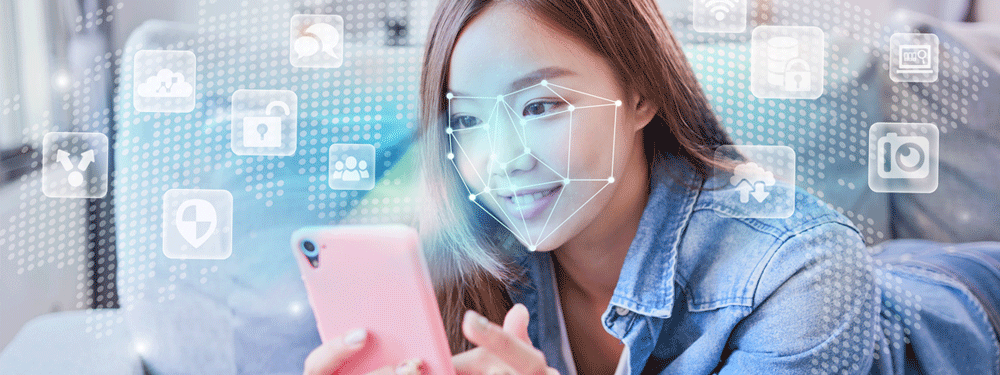 Woman using facial recognition on cell phone