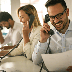 Three workers on Hosted PBX phone
