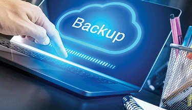 Glowing backup cloud on laptop Featured