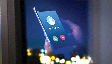 Robo call unknown caller scam on smartphone Featured