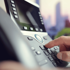 Business person using VoIP phone system