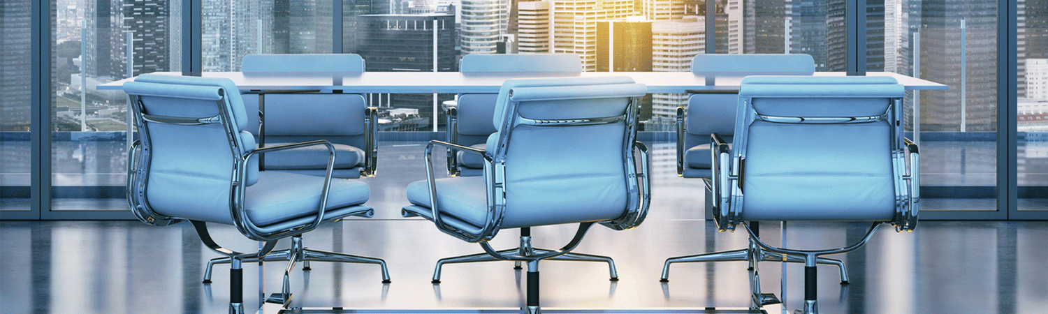Business chairs at an empty table in city