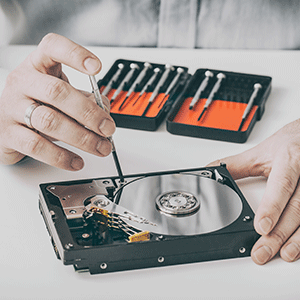 Man working on a hard drive due to failure