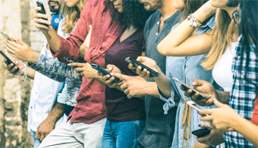 Group of people using cell phones for social media