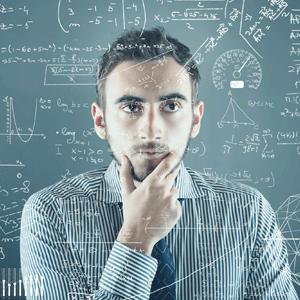 Man looking at equations