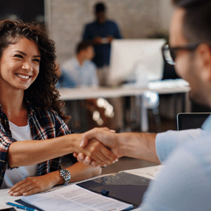 Woman interviewing with business man shaking hands