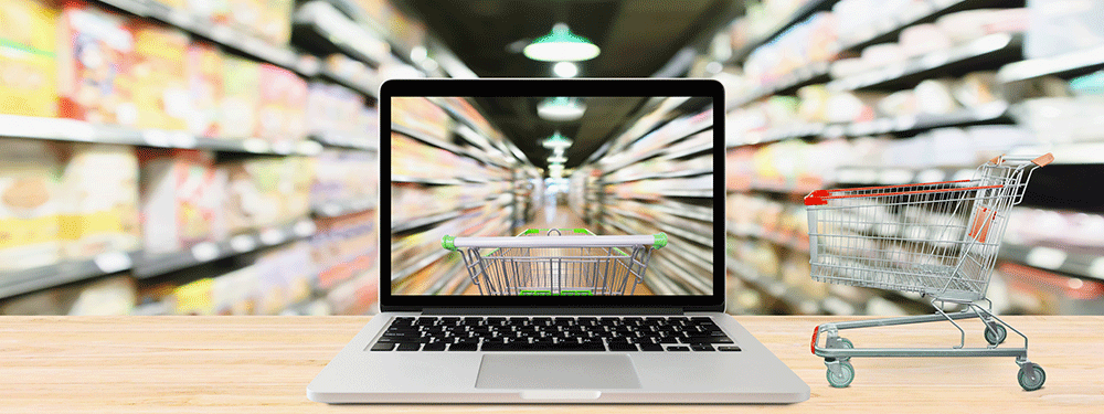 Online grocery shopping on a laptop