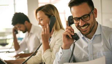 Three Customer Service Reps On Phone Featured