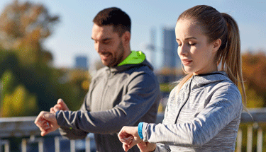 Man and woman checking their wellness technology featured image