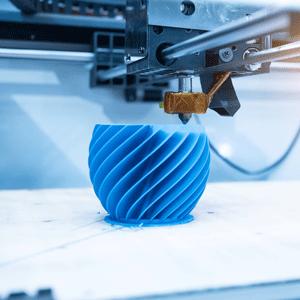 3D printer printing a blue vase