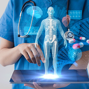 Hologram of human body with bones coming from a tablet