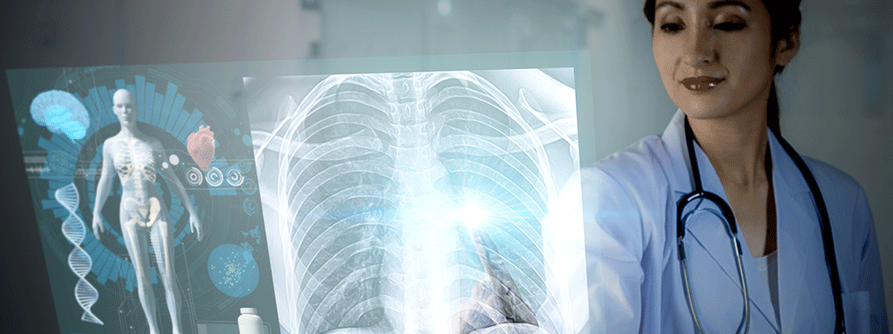 Nurse looking at a scan of rib cage