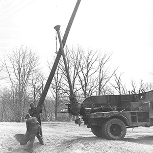 Setting poles up black and white photo