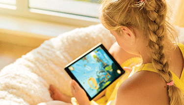 Girl on tablet screen time Featured