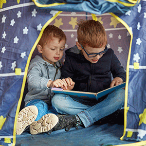 Boys reading together tent books