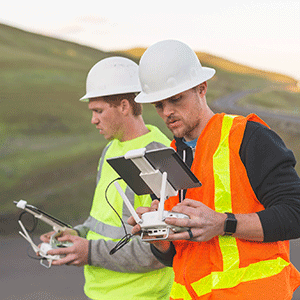 Engineers using drone