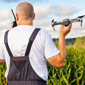 Farmer using drone crops