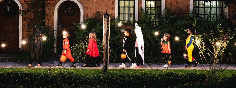Kids trick or treating group walking