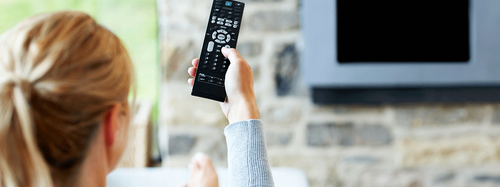 Woman holding TV remote